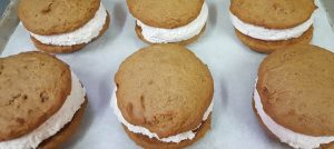 Pumpkin whoopie pies on a tray